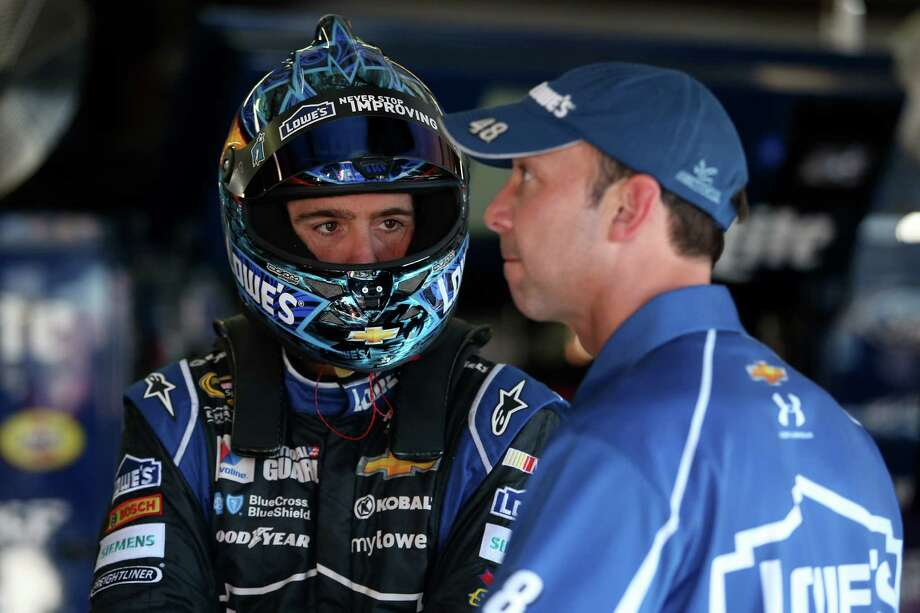 TALLADEGA, AL - OCTOBER 17:  Jimmie Johnson, driver of the #48 Lowe's Chevrolet, talks to his crew chief, Chad Knaus, during practice for the NASCAR Sprint Cup Series GEICO 500 at Talladega Superspeedway on October 17, 2014 in Talladega, Alabama.  (Photo by Todd Warshaw/Getty Images) ORG XMIT: 518738405 Photo: Todd Warshaw / 2014 Getty Images