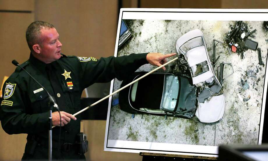Investigator Troy Snelgrove describes a photo of a reconstruction of the crash during testimony on John Goodman's retrial Friday. Goodman is charged with DUI manslaughter in the death of Scott Wilson. / The Palm Beach Post
