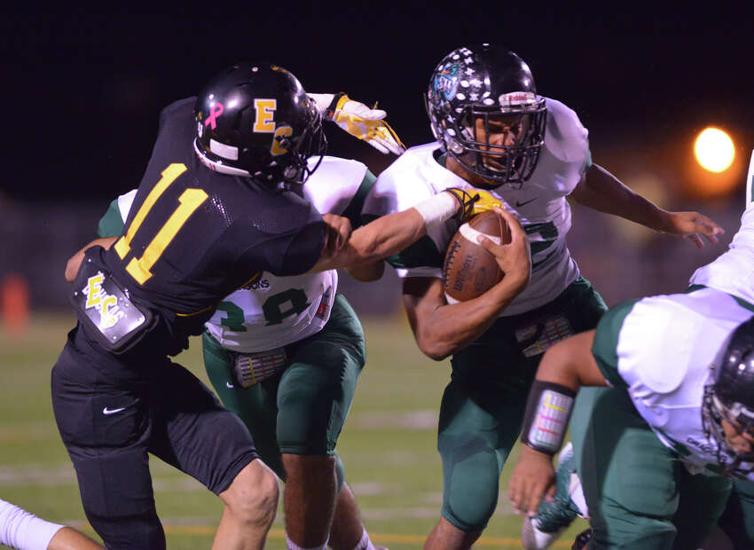 Southwest's Reilly Riggs is grabbed by East Central's Colin Padalecki during their game Friday night.