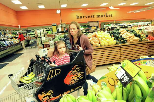 Kara Tubbs of Clifton Park grocery shops with her children Leo, 1, and Melanie, 3, on Tuesday, Oct. 14, 2014, at Hannaford in Clifton Park, N.Y. (Cindy Schultz / Times Union) Photo: Cindy Schultz / 10029015A