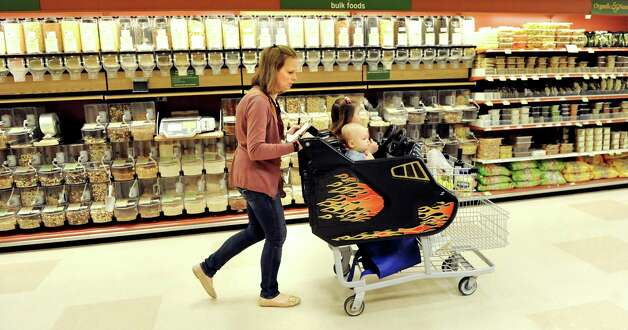 Kara Tubbs of Clifton Park strolls by the bulk foods while grocery shopping with her children Leo, 1, and Melanie, 3, on Tuesday, Oct. 14, 2014, at Hannaford in Clifton Park, N.Y. (Cindy Schultz / Times Union) Photo: Cindy Schultz / 10029015A
