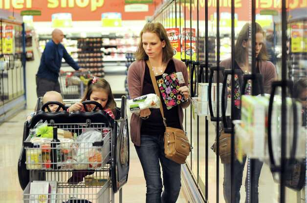 Kara Tubbs of Clifton Park in the frozen food aisle while grocery shopping with her children Leo, 1, and Melanie, 3, on Tuesday, Oct. 14, 2014, at Hannaford in Clifton Park, N.Y. (Cindy Schultz / Times Union) Photo: Cindy Schultz / 10029015A