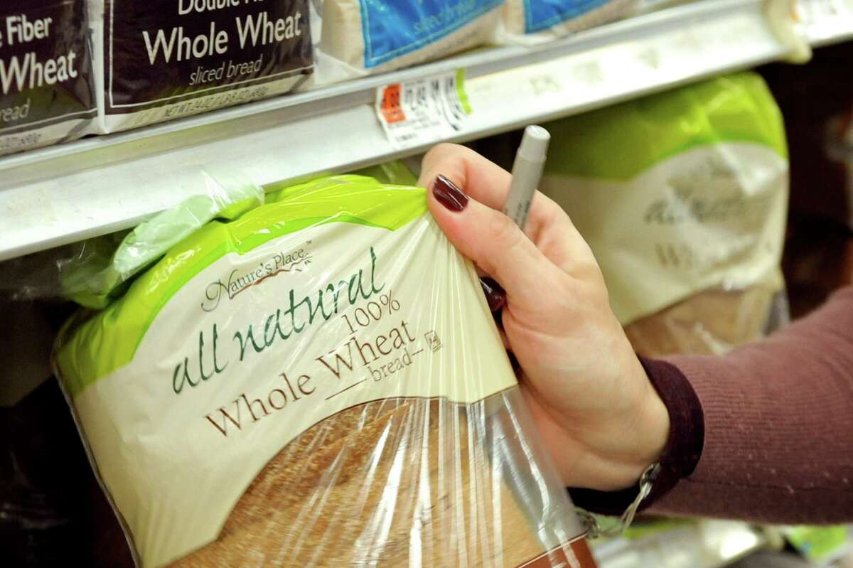 Kara Tubbs of Clifton Park selects a loaf of bread while grocery shopping on Tuesday, Oct. 14, 2014, at Hannaford in Clifton Park, N.Y. (Cindy Schultz / Times Union)