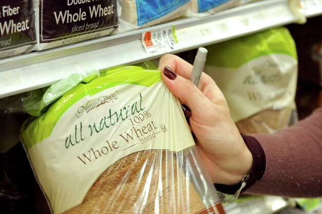 Kara Tubbs of Clifton Park selects a loaf of bread while grocery shopping on Tuesday, Oct. 14, 2014, at Hannaford in Clifton Park, N.Y. (Cindy Schultz / Times Union) Photo: Cindy Schultz / 10029015A
