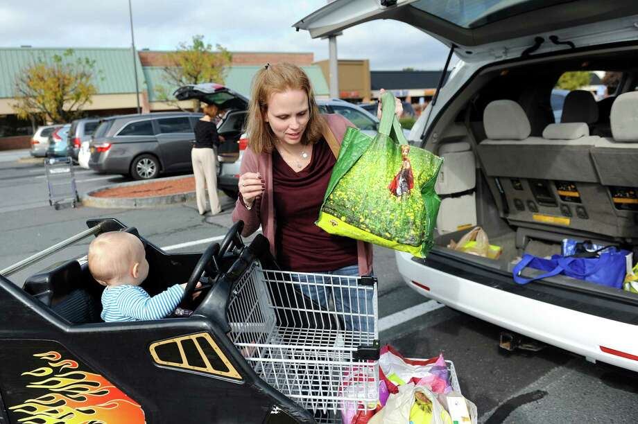 Kara Tubbs of Clifton Park loads groceries into her van after shopping on Tuesday, Oct. 14, 2014, at Hannaford in Clifton Park, N.Y. (Cindy Schultz / Times Union) Photo: Cindy Schultz / 10029015A