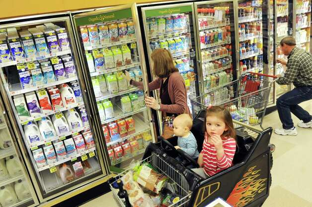 Kara Tubbs of Clifton Park opens the dairy case while grocery shopping with her children Leo, 1, and Melanie, 3, on Tuesday, Oct. 14, 2014, at Hannaford in Clifton Park, N.Y. (Cindy Schultz / Times Union) Photo: Cindy Schultz / 10029015A