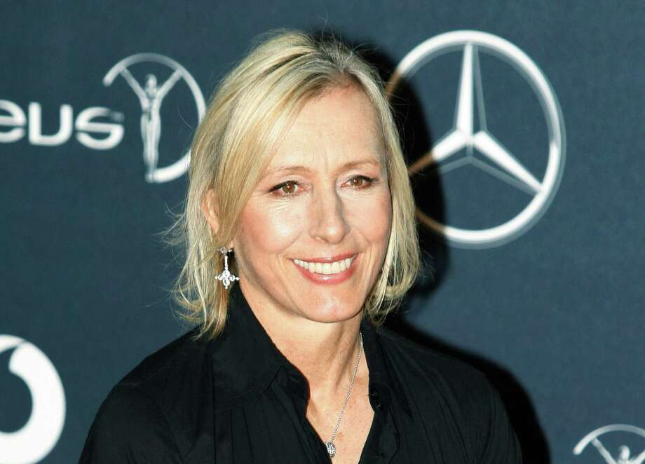 FILE - In this Feb. 6, 2012 file photo, former tennis player Martina Navratilova, arrives for the Laureus World Sports Awards in London. Navratilova will be among the 12 celebrity contestants on the next season of the ABC dancing competition, premiering March 19. (AP Photo/Lefteris Pitarakis, file) Photo: Lefteris Pitarakis / AP2012