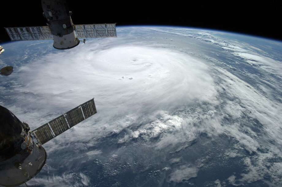 This image provided by NASA shows Hurricane Gonzalo taken from the International Space Station by European Space Agency astronaut Alexander Gerst as it moves toward Bermuda on Thursday, Oct. 16, 2014. Hurricane Gonzalo roared toward Bermuda as a powerful Category 3 storm on Friday. (AP Photo/Alexander Gerst/ESA/NASA) Photo: Alexander Gerst, HOPD / NASA
