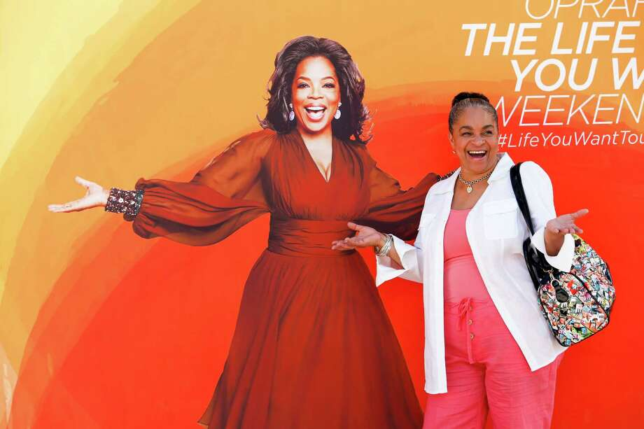 """Fans such as Vanessa Wright on Friday visited Oprah Winfrey's """"O Town,"""" filled with inspirational activities. Photo: Eric Kayne / Eric Kayne"""