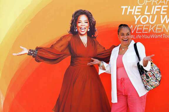 """Fans such as Vanessa Wright on Friday visited Oprah Winfrey's """"O Town,"""" filled with inspirational activities."""