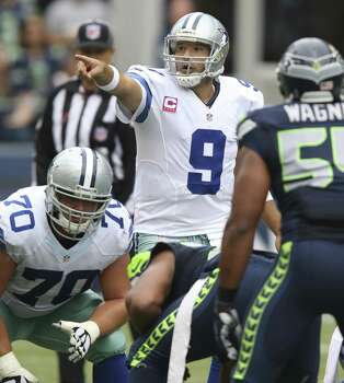 Dallas Cowboys quarterback Tony Romo in the fourth quarter,  in his game against the Seattle Seahawks at CenturyLink Filed during an NFL game in Seattle on Sunday, Oct. 12, 2014. (AP Photo/David Seelig) Photo: David Seelig, Associated Press / FR161686 AP