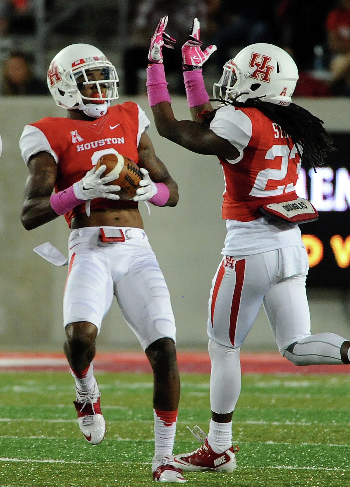 Houston defensive back William Jackson, left, celebrates his interception of Temple quarterback P.J. Walker with Trevon Stewart during the first half of a college football game, Friday, October 17, 2014, at TDECU Stadium in Houston.