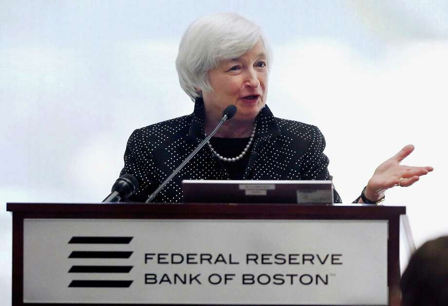 Federal Reserve Chairman Janet Yellen speaks during a conference on economic opportunity at the Federal Reserve Bank in Boston, Friday, Oct. 17, 2014. Yellen said that the last several decades have seen the most sustained rise in income inequality in a century. (AP Photo/Michael Dwyer) Photo: Michael Dwyer, STF / AP
