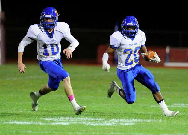 Queensbury quarterback Drew Wilson (10) blocks for runningback Tyrell Adams (20) as he runs the ball against Burnt Hills-Ballston Lake during the first half of their Section II Class A football game on Friday, Sept. 17, 2014, in Burnt Hills, N.Y. (Hans Pennink / Special to the Times Union) ORG XMIT: HP102 Photo: Hans Pennink / Hans Pennink