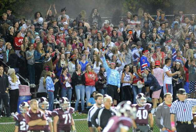 Burnt Hills-Ballston Lake fans cheer as their team plays Queensbury during the first half of their Section II Class A football game on Friday, Sept. 17, 2014, in Burnt Hills, N.Y. (Hans Pennink / Special to the Times Union) ORG XMIT: HP101 Photo: Hans Pennink / Hans Pennink