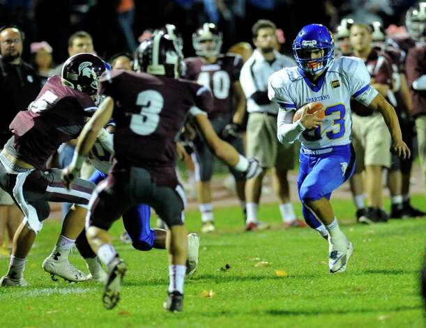 Queensbury's Brett Rodriguez (33) runs the ball against Burnt Hills-Ballston Lake during the first half of their Section II Class A football game on Friday, Sept. 17, 2014, in Burnt Hills, N.Y. (Hans Pennink / Special to the Times Union) ORG XMIT: HP104 Photo: Hans Pennink / Hans Pennink