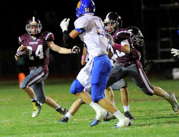 Burnt Hills-Ballston Lake's Johnny O'Donnell (24) runs the ball against Queensbury's during the first half of their Section II Class A football game on Friday, Sept. 17, 2014, in Burnt Hills, N.Y. (Hans Pennink / Special to the Times Union) ORG XMIT: HP107 Photo: Hans Pennink / Hans Pennink