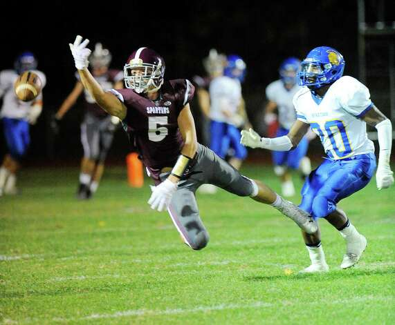 Burnt Hills-Ballston Lake's Packy Brown (5) can't hold onto a pass while being defended by Queensbury's Tyrell Adams (20) during the first half of their Section II Class A football game on Friday, Sept. 17, 2014, in Burnt Hills, N.Y. (Hans Pennink / Special to the Times Union) ORG XMIT: HP106 Photo: Hans Pennink / Hans Pennink