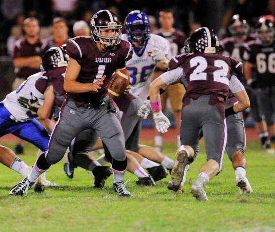 Burnt Hills-Ballston Lake quarterback John Clayton (1) in action against Queensbury during the first half of their Section II Class A football game on Friday, Sept. 17, 2014, in Burnt Hills, N.Y. (Hans Pennink / Special to the Times Union) ORG XMIT: HP108 Photo: Hans Pennink / Hans Pennink