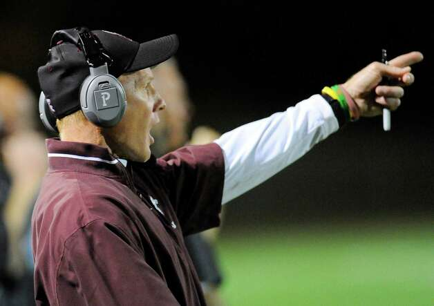Burnt Hills-Ballston Lake head coach Matt Shell instructs his players against Queensbury during the first half of their Section II Class A football game on Friday, Sept. 17, 2014, in Burnt Hills, N.Y. (Hans Pennink / Special to the Times Union) ORG XMIT: HP109 Photo: Hans Pennink / Hans Pennink