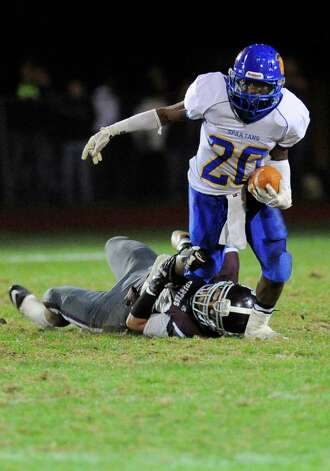 Queensbury's Tyrell Adams (20) Burnt Hills-Ballston Lake during the first half of their Section II Class A football game on Friday, Sept. 17, 2014, in Burnt Hills, N.Y. (Hans Pennink / Special to the Times Union) ORG XMIT: HP110 Photo: Hans Pennink / Hans Pennink