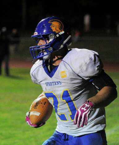 Queensbury's Christopher Goudy (21) scores a touchdown against Burnt Hills-Ballston Lake during the first half of their Section II Class A football game on Friday, Sept. 17, 2014, in Burnt Hills, N.Y. (Hans Pennink / Special to the Times Union) ORG XMIT: HP111 Photo: Hans Pennink / Hans Pennink