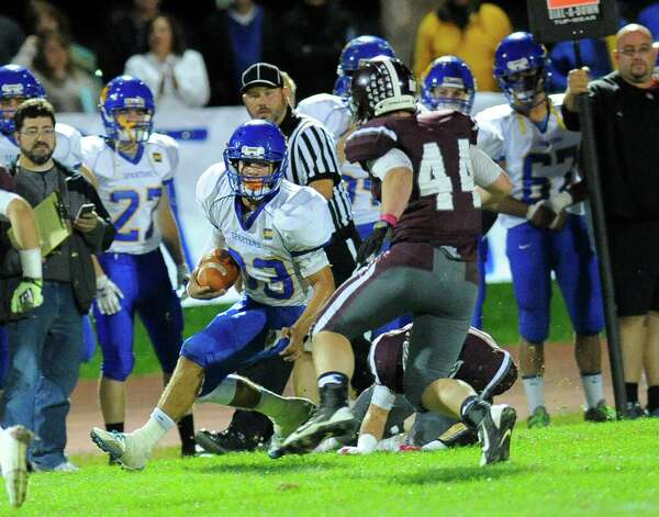 Queensbury's Brett Rodrigez (33) is defended by Burnt Hills-Ballston Lake's Alex Roney (44) during the first half of their Section II Class A football game on Friday, Sept. 17, 2014, in Burnt Hills, N.Y. (Hans Pennink / Special to the Times Union) ORG XMIT: HP112 Photo: Hans Pennink / Hans Pennink