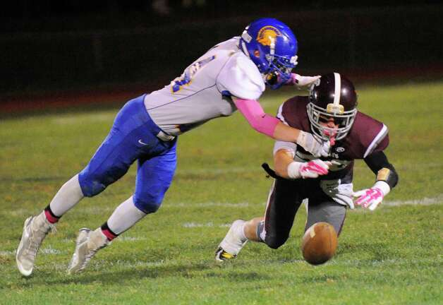 Queensbury's Ian Kirkpatrick ,left, breaks up a pass intended for Burnt Hills-Ballston Lake's Tyler Dowdle ,right, during the first half of their Section II Class A football game on Friday, Sept. 17, 2014, in Burnt Hills, N.Y. (Hans Pennink / Special to the Times Union) ORG XMIT: HP113 Photo: Hans Pennink / Hans Pennink