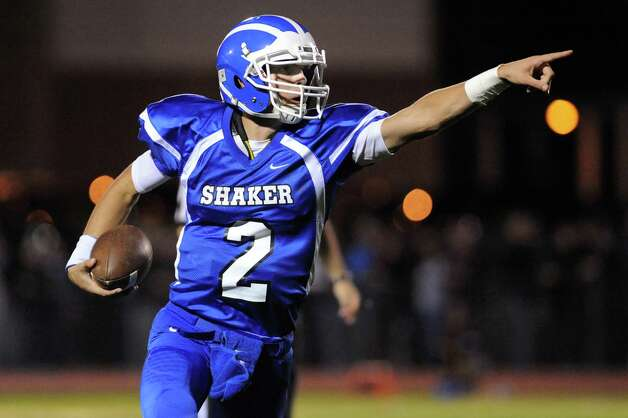 Shaker's quarterback Matt Woods signals a teammate as he carries the ball during their football game against Colonie on Friday, Oct. 17, 2014, at Shaker High in Latham, N.Y. (Cindy Schultz / Times Union) Photo: Cindy Schultz / 00029059A