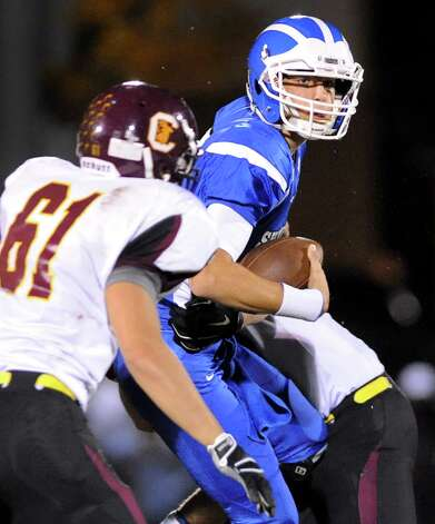 Shaker's quarterback Matt Woods, right, gets pressure from the Colonie defense during their football game on Friday, Oct. 17, 2014, at Shaker High in Latham, N.Y. (Cindy Schultz / Times Union) Photo: Cindy Schultz / 00029059A