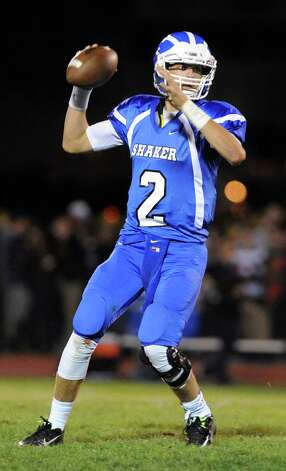 Shaker's quarterback Matt Woods looks to pass during their football game against Colonie on Friday, Oct. 17, 2014, at Shaker High in Latham, N.Y. (Cindy Schultz / Times Union) Photo: Cindy Schultz / 00029059A