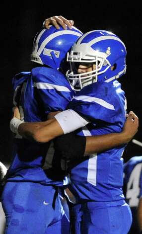 Shaker's Brandon Barlow, left, celebrates a touchdown with quarterback Matt Woods during their football game against Colonie on Friday, Oct. 17, 2014, at Shaker High in Latham, N.Y. (Cindy Schultz / Times Union) Photo: Cindy Schultz / 00029059A