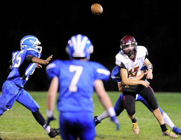 Colonie's quarterback Will McCann, right, throws a pass under pressure as Shaker's Brandon Barlow, left, moves in for an interception during their football game on Friday, Oct. 17, 2014, at Shaker High in Latham, N.Y. (Cindy Schultz / Times Union) Photo: Cindy Schultz / 00029059A