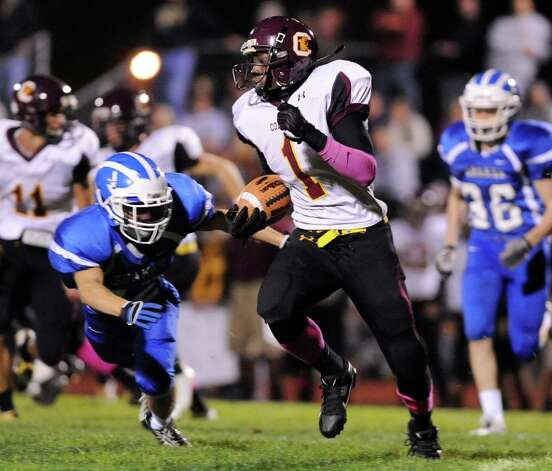 Colonie's Jay Newsom, center, gains yards as Shaker's Mitch Flanger, left, defends during their football game on Friday, Oct. 17, 2014, at Shaker High in Latham, N.Y. (Cindy Schultz / Times Union) Photo: Cindy Schultz / 00029059A