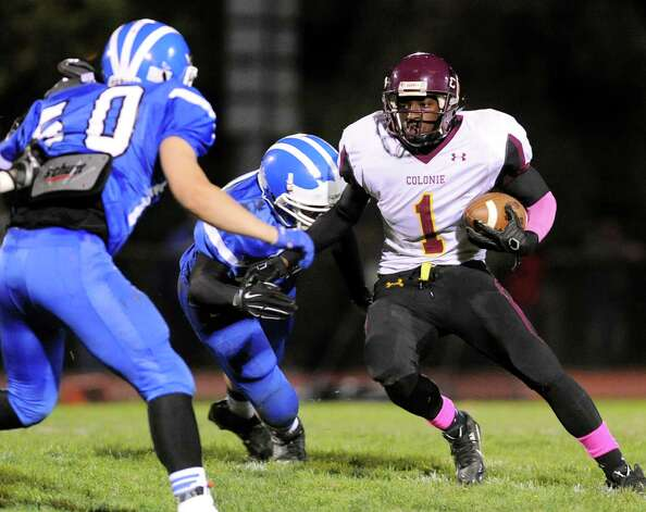 Colonie's Jay Newsom, right, carries the ball during their football game against Shaker on Friday, Oct. 17, 2014, at Shaker High in Latham, N.Y. (Cindy Schultz / Times Union) Photo: Cindy Schultz / 00029059A