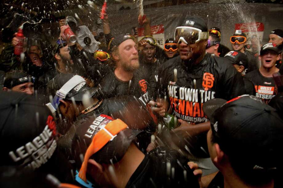 Hunter Pence, center left, and his Giants teammates are lately becoming used to having celebrations in the locker room during October. Photo: Jose Luis Villegas, MBI / The Sacramento Bee