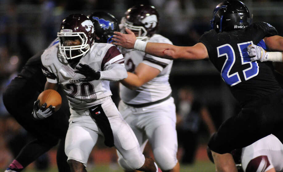 Clear Creek running back Jaiden Woodson (20) rushed for 125 yards on 27 carries to help the Wildcats beat Friendswood 48-21 on Friday night and stay tied with Dickinson for first place in District 24-6A. Photo: Jerry Baker, Freelance