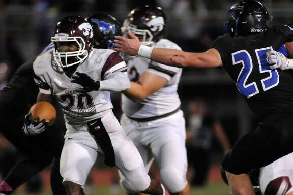 Clear Creek running back Jaiden Woodson (20) rushed for 125 yards on 27 carries to help the Wildcats beat Friendswood 48-21 on Friday night and stay tied with Dickinson for first place in District 24-6A.