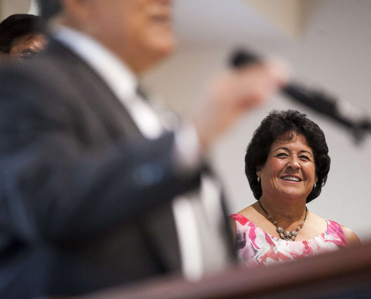 Golf legend Nancy Lopez, a 48-time winner on the LPGA Tour, smiles during her induction into the National Hispanic Sports Hall of Fame at the San Fernando Community Center.