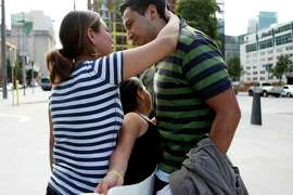 After nine months in detention in Texas, Guatamalan refugee Ricardo Martinez reunites with his wife Ameli Rodriguez and daughter Milly Nicole, 8, at the Greyhound Bus Station in San Francisco, Calif. on Friday, October 17, 2014.