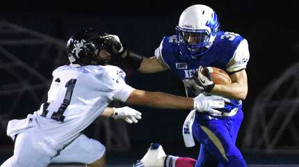 Photos from Newtown's 14-8 win over Ansonia in the high school football game at Newtown High School in Newtown, Conn. Friday, Oct. 17, 2014.