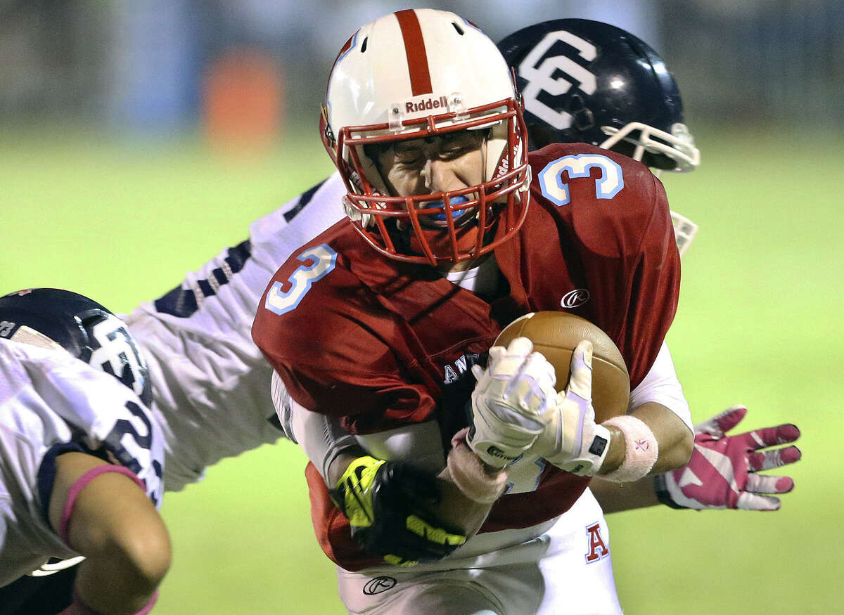 Antonian receiver Matthew Tabet braces for impact as he's wrapped up by a Central Catholic defender at Ferrara Stadium.