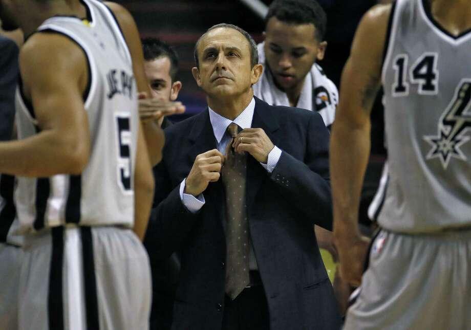 Spurs assistant coach Ettore Messina (center) took over for Gregg Popovich in Thursday's preseason loss to the Suns. Photo: Matt York, Associated Press / AP