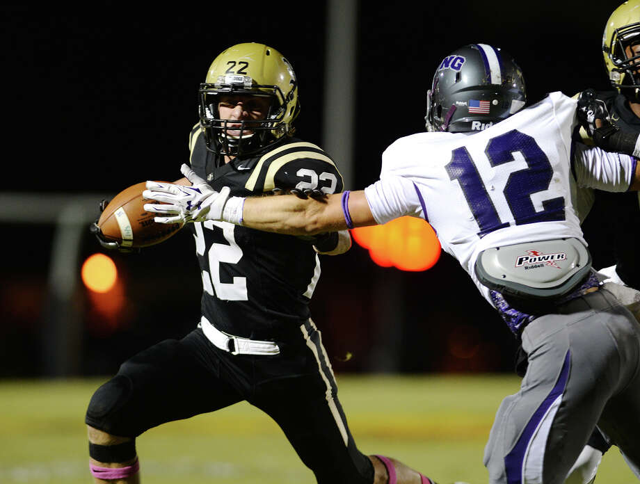 Nederland's Austin Krautz, No. 22, tries to stay away from Port Neches-Groves' Ky Walker, No. 12, during Friday's game. The Nederland Bulldogs hosted the Port Neches-Groves Indianson Friday night. Both teams were 3-0 in district play. Photo taken Friday 10/17/14 Jake Daniels/@JakeD_in_SETX Photo: Jake Daniels / ©2014 The Beaumont Enterprise/Jake Daniels