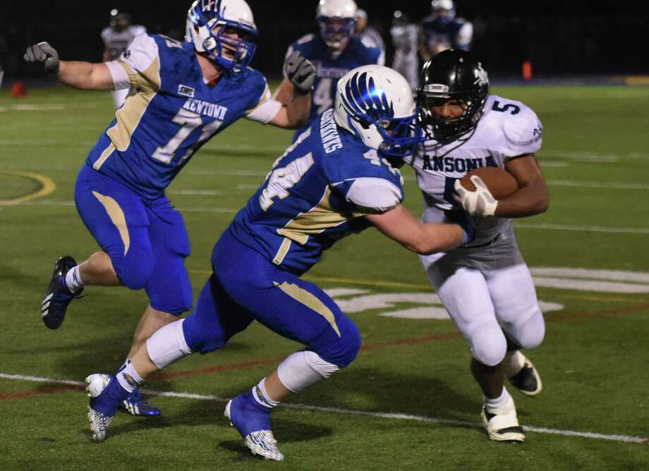 Photos from Newtown's 14-8 win over Ansonia in the high school football game at Newtown High School in Newtown, Conn. Friday, Oct. 17, 2014. Photo: Tyler Sizemore / The News-Times