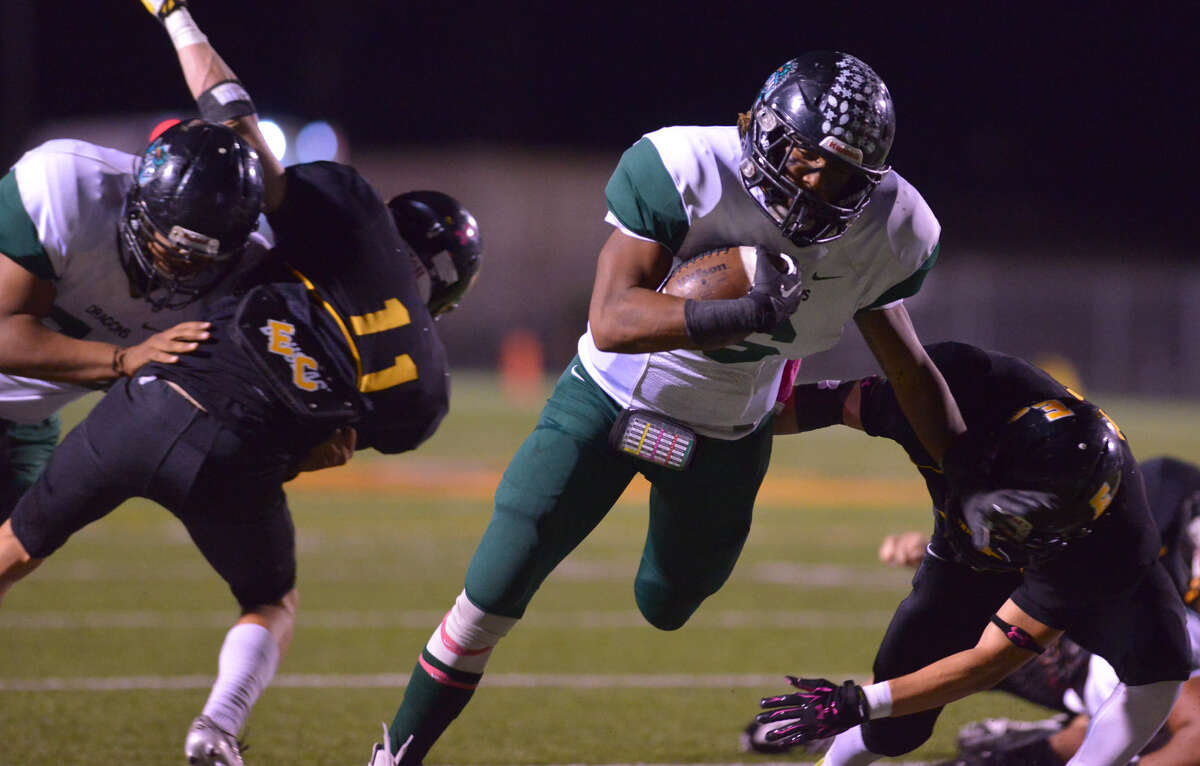 Southwest sophomore Tyrone Middleton, who finished with 153 yards rushing, including an 85-yard scoring jaunt, breaks through the East Central line Friday night.