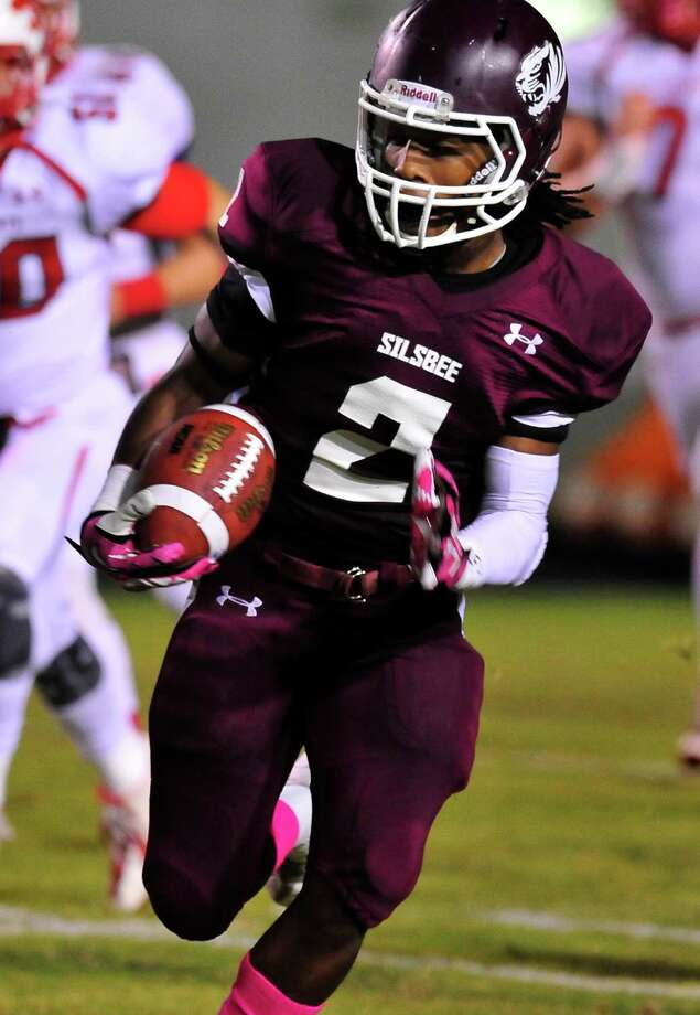 Silsbee's Ta'varis Brooks runs the ball against Splendora during Friday's home game at Tiger Stadium. Photo taken Friday, October 17, 2014 Kim Brent/@kimbpix Photo: Kim Brent / Beaumont Enterprise