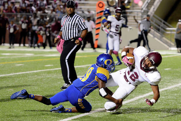 Central Jaguar Devwah Whaley, 12, flys into the endzone with Ozen Panther Edward Adams, 19, trying to prevent the score. This was shortly after Central recovered it's own fumble for additional yardage at the Carroll Thomas Stadium October 17, 2014. Photo by Drew Loker Photo: Drew Loker / ©2014. www.DrewLoker.com