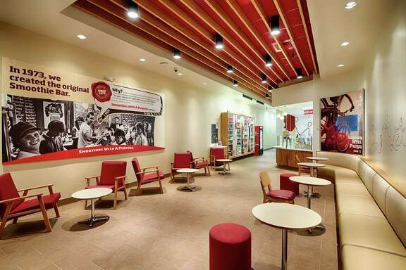 Smoothie King plans to open four Houston-area stores by the end of this year and as many as six more in 2015 as part of its Texas push. The photos show the new design that will be used in the company's stores, featuring comfortable seating areas.