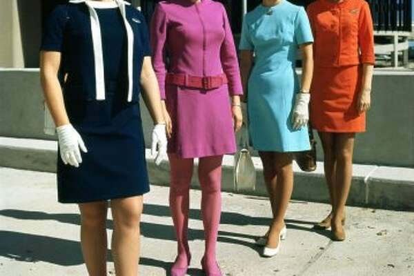 Flight attendants Nina Hammock of Eastern, Braniff's Ann Ruckstuhl, Delta's Gay Wilson and Texas International Edie Burrs at Houston Intercontinental Airport. May 1969. Story published in the June 15, 1969, Tempo.